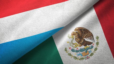Luxembourg and Mexico flags together textile cloth, fabric texture Stock Photo