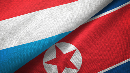 Luxembourg and North Korea two folded flags together