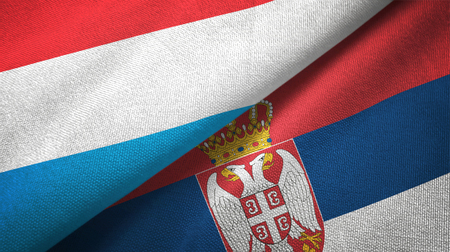Luxembourg and Serbia flags together textile cloth, fabric texture Stock Photo