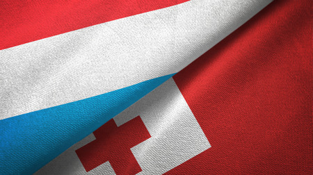 Luxembourg and Tonga two folded flags together