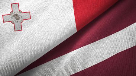 Malta and Latvia flags together textile cloth, fabric texture Stok Fotoğraf