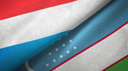 Luxembourg and Uzbekistan flags together textile cloth, fabric texture