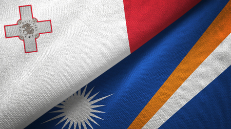 Malta and Marshall Islands two folded flags together