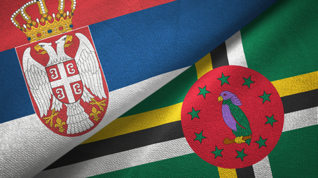 Serbia and Dominica two folded flags together 写真素材