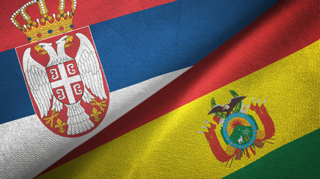 Serbia and Bolivia flags together textile cloth, fabric texture