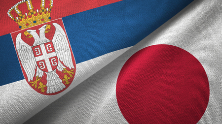 Serbia and Japan flags together textile cloth, fabric texture