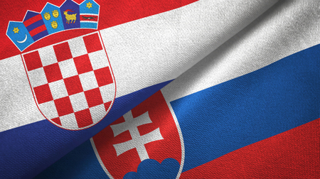Croatia and Slovakia two flags textile cloth, fabric texture Standard-Bild