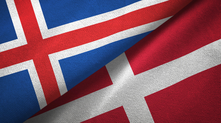 Iceland and Denmark flags together textile cloth, fabric texture Archivio Fotografico