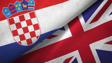 Croatia and United Kingdom flags together textile cloth, fabric texture Standard-Bild
