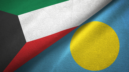 Kuwait and Palau two folded flags together