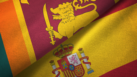 Sri Lanka and Spain two flags textile cloth, fabric texture Standard-Bild