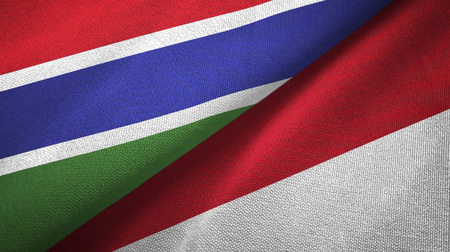 Gambia and Indonesia two flags textile cloth, fabric texture