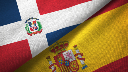 Dominican Republic and Spain two flags textile cloth, fabric texture 스톡 콘텐츠