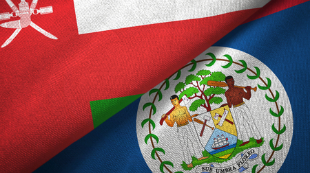 Oman and Belize two flags textile cloth, fabric texture Stock Photo