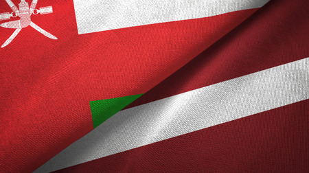 Oman and Latvia two flags textile cloth, fabric texture