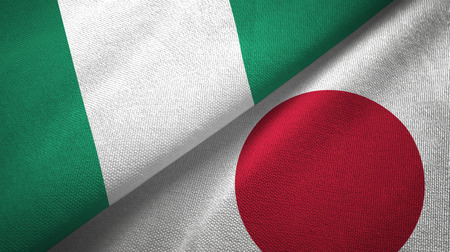 Nigeria and Japan two flags textile cloth, fabric texture