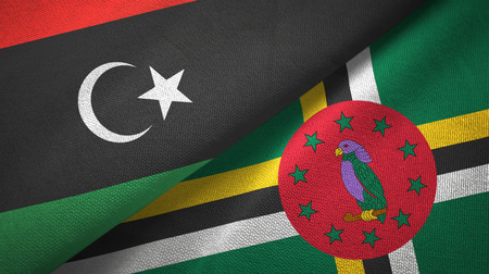 Libya and Dominica two flags textile cloth, fabric texture Zdjęcie Seryjne - 122335168
