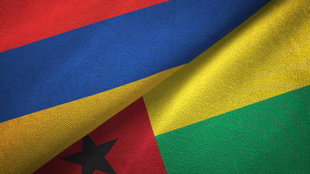 Armenia and Guinea-Bissau two flags textile cloth, fabric texture Stock Photo