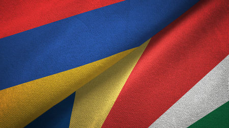 Armenia and Seychelles two flags textile cloth, fabric texture Stock Photo
