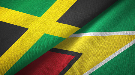 Jamaica and Guyana two flags textile cloth, fabric texture