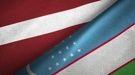 Latvia and Uzbekistan two flags textile cloth, fabric texture Stock Photo