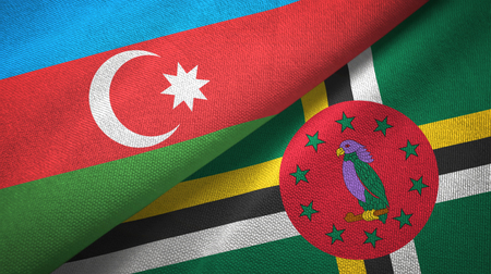 Azerbaijan and Dominica two flags textile cloth, fabric texture 版權商用圖片