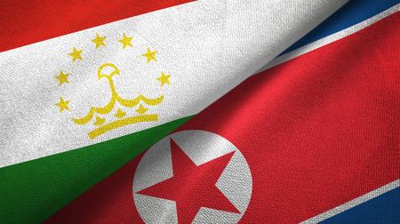 Tajikistan and North Korea two folded flags together