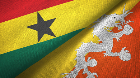 Ghana and Bhutan two flags textile cloth, fabric texture Stock Photo