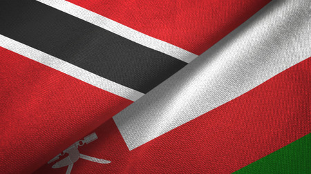Trinidad and Tobago and Oman two flags textile cloth, fabric texture Stock Photo