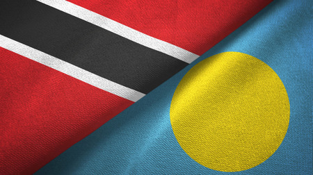 Trinidad and Tobago and Palau two flags textile cloth, fabric texture Stock Photo