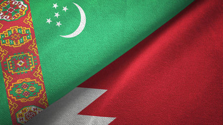 Turkmenistan and Bahrain two folded flags together