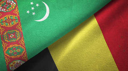 Turkmenistan and Belgium flags together textile cloth, fabric texture Stock Photo
