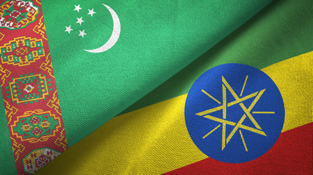 Turkmenistan and Ethiopia two folded flags together