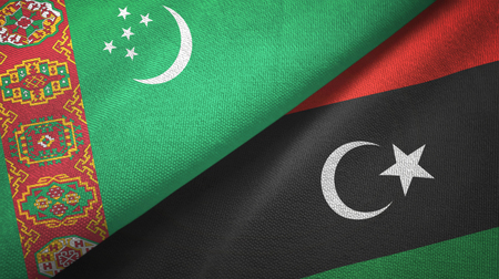 Turkmenistan and Libya flags together textile cloth, fabric texture Stock Photo
