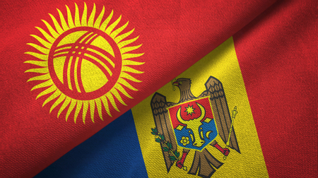 Kyrgyzstan and Moldova flags together textile cloth, fabric texture Imagens