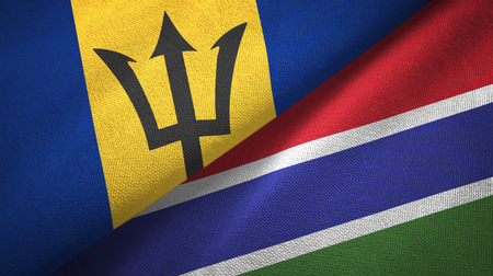 Barbados and Gambia two folded flags together Banque d'images