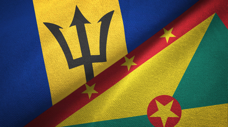 Barbados and Grenada two flags textile cloth, fabric texture Stock Photo