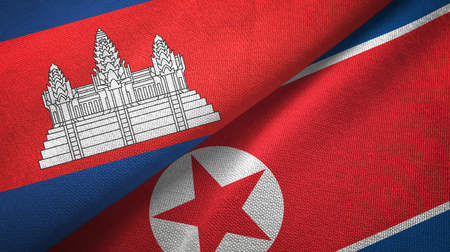 Cambodia and North Korea two flags textile cloth, fabric texture