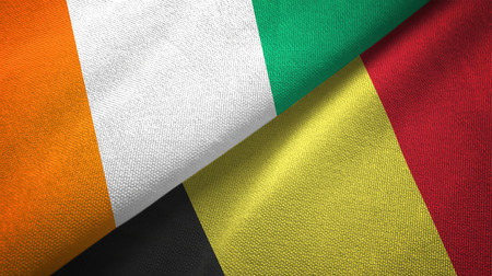 Cote dIvoire and Belgium two flags textile cloth, fabric texture Stock Photo
