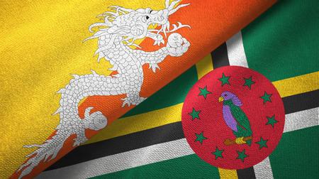 Bhutan and Dominica two flags textile cloth, fabric texture Reklamní fotografie