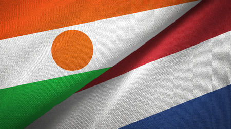 Niger and Netherlands flags together textile cloth, fabric texture Foto de archivo