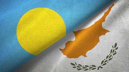 Palau and Cyprus flags together textile cloth, fabric texture Reklamní fotografie