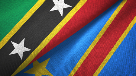 Saint Kitts and Nevis and Congo Democratic Republic two flags textile cloth Reklamní fotografie
