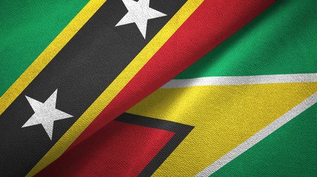 Saint Kitts and Nevis and Guyana two flags textile cloth, fabric texture Stock Photo