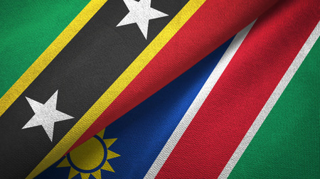 Saint Kitts and Nevis and Namibia two flags textile cloth, fabric texture Reklamní fotografie