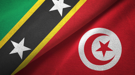 Saint Kitts and Nevis and Tunisia two flags textile cloth, fabric texture Banque d'images