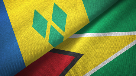 Saint Vincent and the Grenadines and Guyana two flags Stock Photo