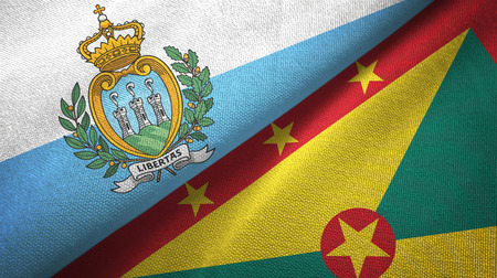 San Marino and Grenada two flags textile cloth, fabric texture Stock Photo