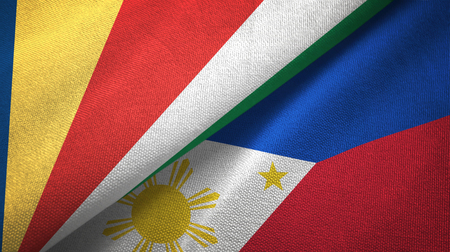 Seychelles and Philippines two flags textile cloth, fabric texture Stock Photo