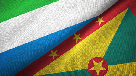 Sierra Leone and Grenada two flags textile cloth, fabric texture Stock Photo